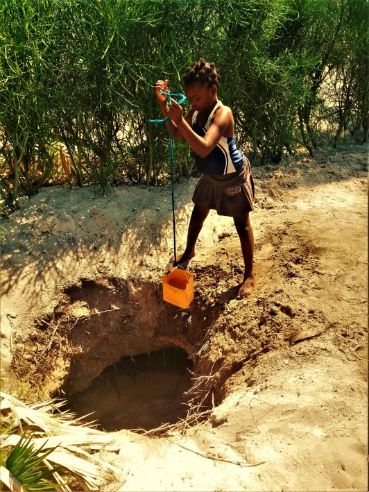 Collecting water from the fresh water pit on the island